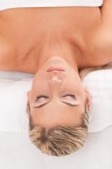 Beautiful woman lying in a spa