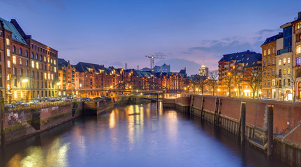 Old warehouses in the historic Speicherstadt in Hamburg at night