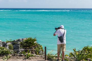 Tourist Photographer taking photos of Tulum, Caribbean paradise,