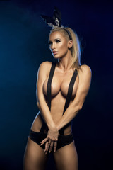 Erotic easter shoot of sexy blonde woman with rabbit ears