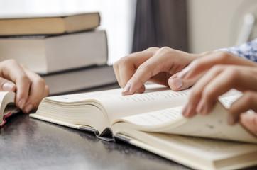 Closeup of human hand reading