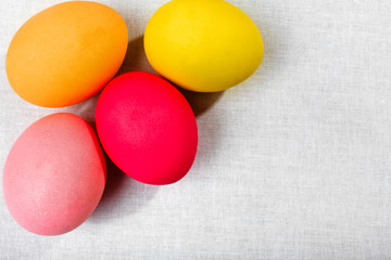 Easter eggs on the white cloth background