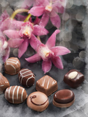 Chocolate pralines decorated with with orchids