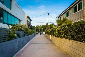 Walkway between houses in Venice Beach, Los Angeles, California.