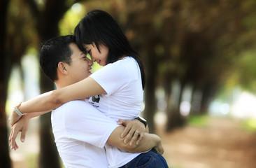 photograph of asian couple outdoor