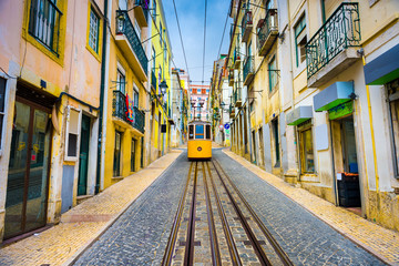 City street with yellow funicular, Lisbon, Portugal