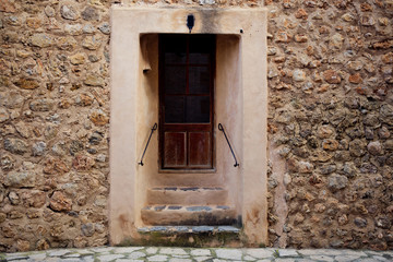 traditional old door and wall in the historic village Deia