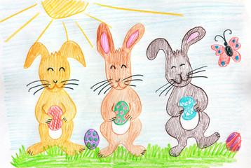 drei lustige Osterhasen mit bemalten Eiern