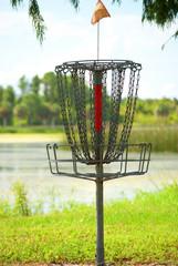 Disc Golf Basket by a Lake