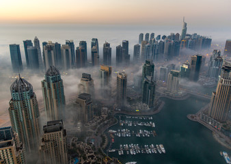 sunrise aerial view skyscraper foggy weather Dubai Marina