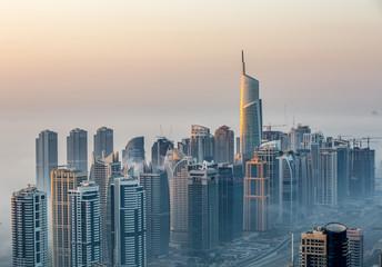 sunrise aerial view skyscraper foggy weather Dubai