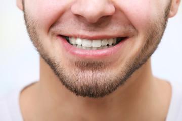 Smiling man after visit dentist close up