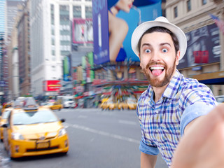 Happy young man taking a selfie photo in NYC, USA