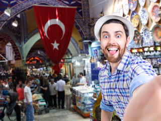 Happy young man taking a selfie photo in Grand Bazar, Istanbul