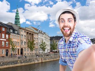 Happy young man taking a selfie photo in Copenhagen, Denmark