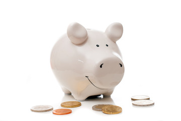 White porcelain pig with few euro coins