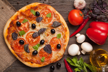 Traditional baked italian pizza margherita with tomatoes olives