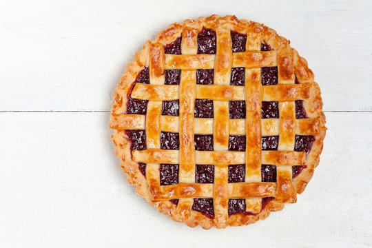 Raspberry pie with fresh raspberries on white background