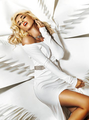 Fabulous lady lying on white sheet