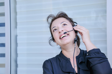 Happy support phone operator in headset