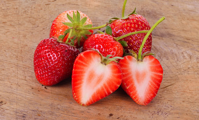 The strawberry on wood background