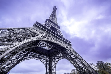 Eiffel Tower scenic bottom view. Purple sky