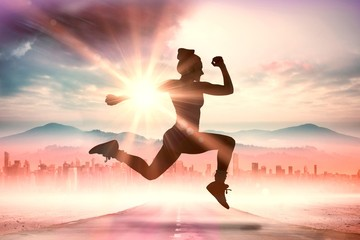 Composite image of fit brunette running and jumping