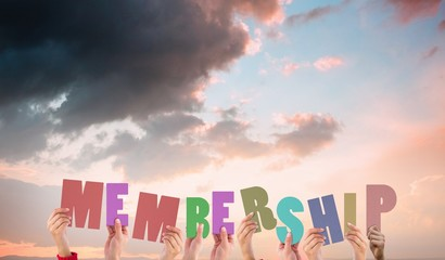 Composite image of hands holding up membership