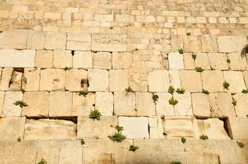 Western wall - the main jewish sacred place of Jerusalem .