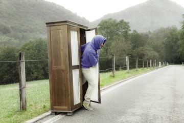 wooden wardrobe, man inside