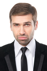Close-up portrait of elegant businessman in black suit. Isolated