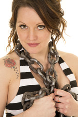 woman with striped tank and tattoo chain around neck close