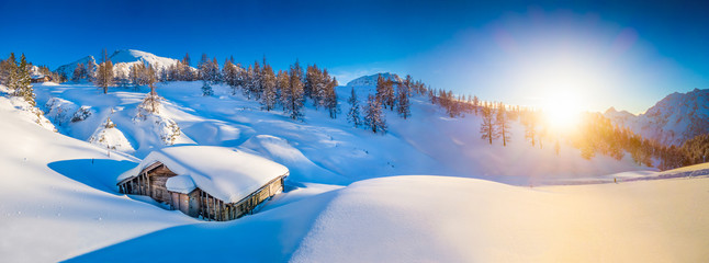 Wall Mural - Winter landscape in the Alps at sunset with old mountain cottage