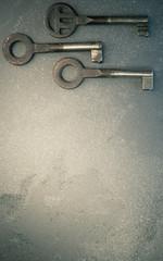three rusty old metal keys