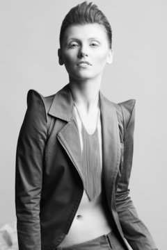 High fashion concept. Androgynous model with short hair