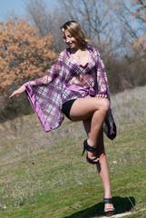 Outdoor shoot ,green field, Model is wearing a purple dress