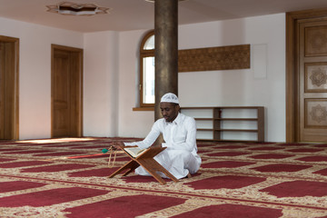 African Muslim Man Reading Holy Islamic Book Koran