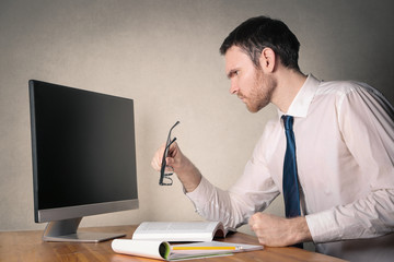 Businessman looking at a blank monitor