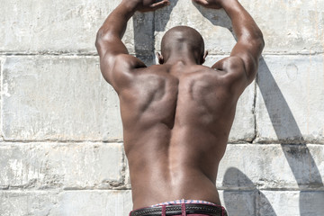 Topless, fit muscular african american male model