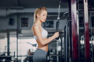 Beautiful blonde doing gym exercises