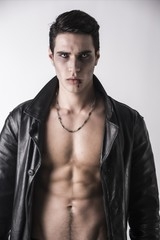 Young Vampire Man in an Open Black Leather Jacket, Showing his