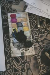 Closeup of watercolor set on artist desk