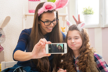 Easter - Mother and daughter with bunny ears, made Selfie photo