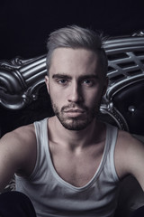 Fashion blond Male young man with beard portrait in bedroom at n