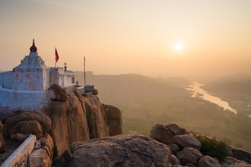 Monkey temple at sunrise hampi india Wall mural