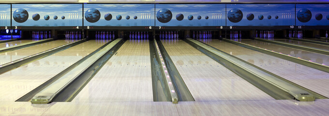 Close up of bowling balls, bowling pins