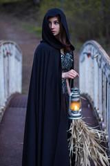 girl with a lantern on the bridge