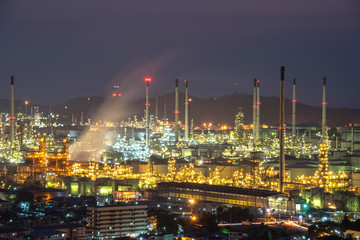 Oil refinery in the twilight sky