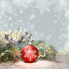 Decorated Christmas tree and red bauble, text space