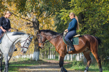 Girls  riding a horse
